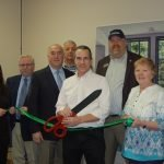 Ribbon Cutting Ceremony at the New Office of Ernest L. Tomkiewicz CPA PLLC. Attending are: in front, Ernest L. Tomkiewicz CPA PLLC. First row from left to right: Rebecca Bunyard, Ambassador; Tim Sink, Chamber president; Concord New Hampshire Mayor Jim Bouley. Back row from left to right: Dick Bean, Mark Lester and Membership Manager Angie Borden